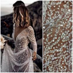 🆕 haft na tiulu VL-269 zdobiony małymi cekinami w kolorze srebrnym, dużymi odstającymi cekinami w kolorze ivory , srebrnymi koralikami i platynową nitką. Piękny i wyjątkowy wzór już w sprzedaży. #lace #lacebride #weddingdress #weddinginspiration #koronkislubne #tkaninyslubne #tiule #wedding