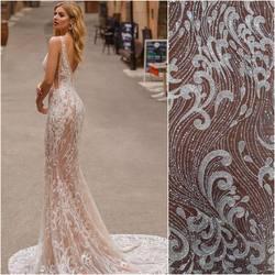 Suknia z kolekcji La Petra 😍 i nasza koronka kod: HT-110 w kolorze ivory zdobiona koralikami i transparentnymi cekinami. Już w sprzedaży 😀#lace #weddingdress #weddinginspiration #wedding #lacebridalcouture #lacefabric #tkaninyslubne #koronkislubne