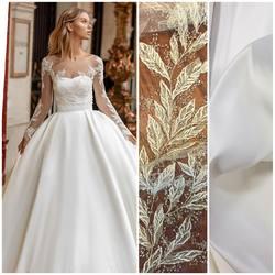 Połączenie delikatnej koronki z koralikami kod: VL-240 oraz gruba matowa satyna kod: AT-4 w kolorze light ivory. Inspiracja jest suknia z kolekcji Milla Nova 😍#millanova #weddingdress #wedding #weddinginspirasi #weddinglace #lace #lacedress #laceinspiration #koronki #koronkislubne #tkaninyslubne #satindress #satin #bride #hurtowniatkanin #scarlett #warszawa